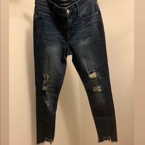 EXPRESS ankle length jeans with distressing.